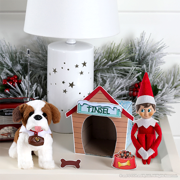 Dog house printable on display with dog and elf