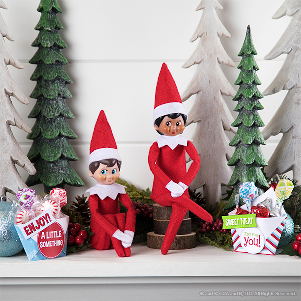 Elves on mantle with treat boxes
