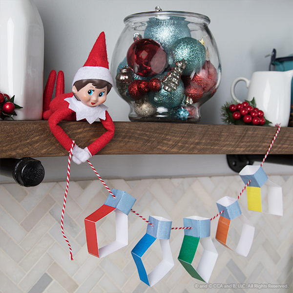 Elf with paper garland