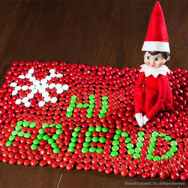 Elf with a message made of candy
