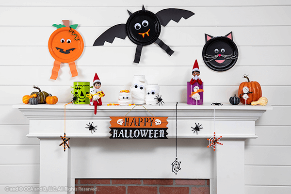 All Halloween crafts with elf on mantle