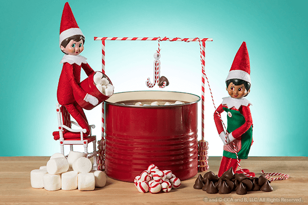 Elves making cocoa with ingredients