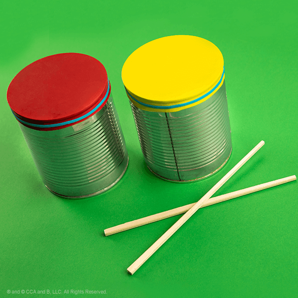 homemade tin drums on green background