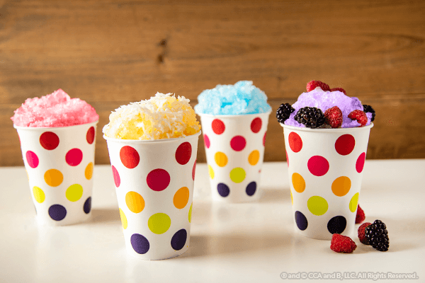 Four finished snow cones in cups