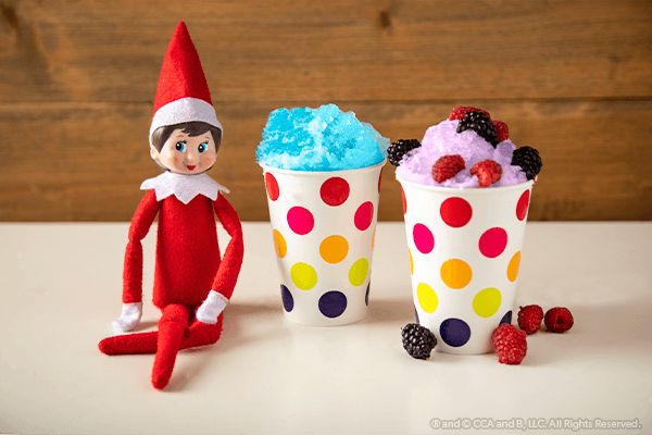 Two finished snow cones with seated elf