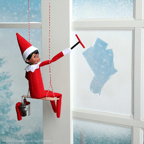 Elf wiping a window