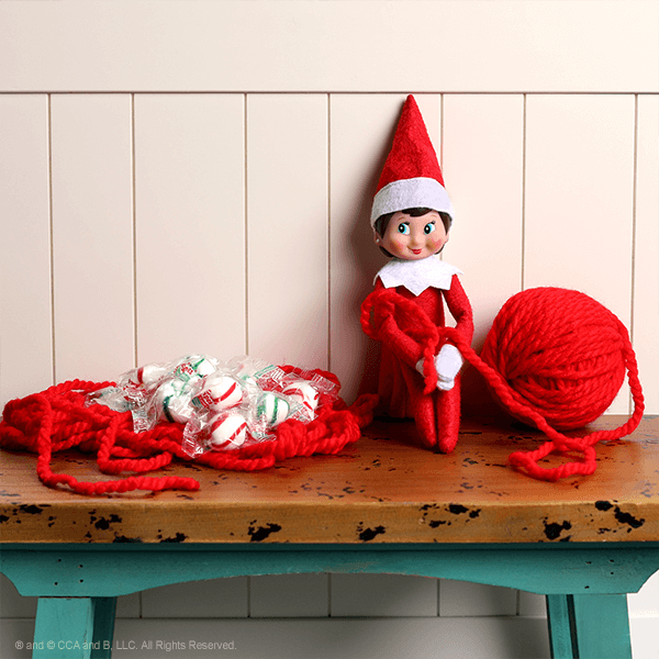Elf tied up in yarn and candy