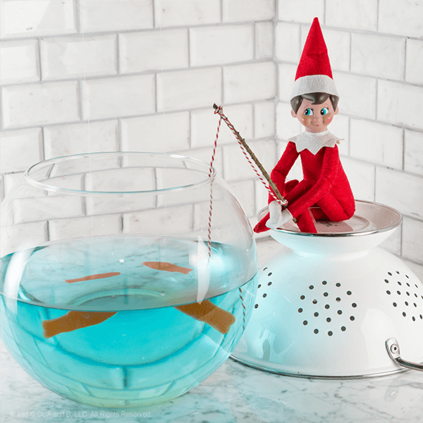 Elf with fishing pole dipped in blue fishbowl