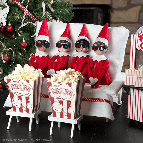 Four elves with 3D glasses and popcorn