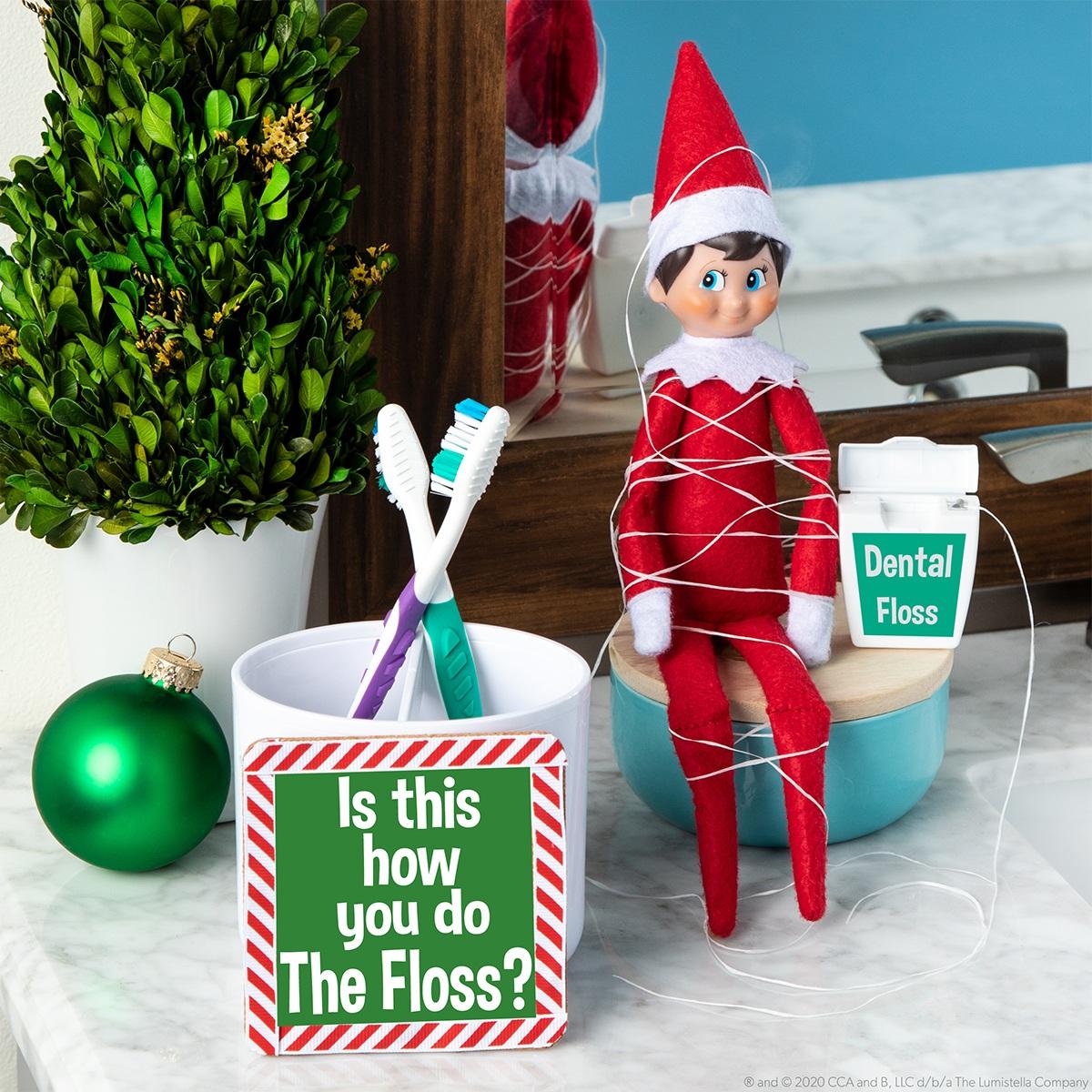 Elf tied up in floss