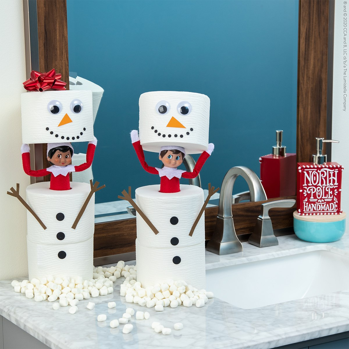Elves popping out of toilet paper snowmen