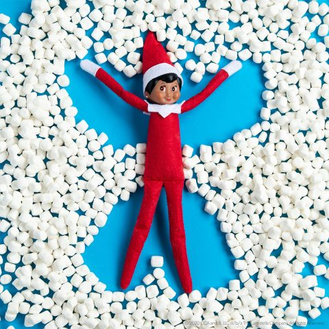 elf doing a snow angel in marshmallows