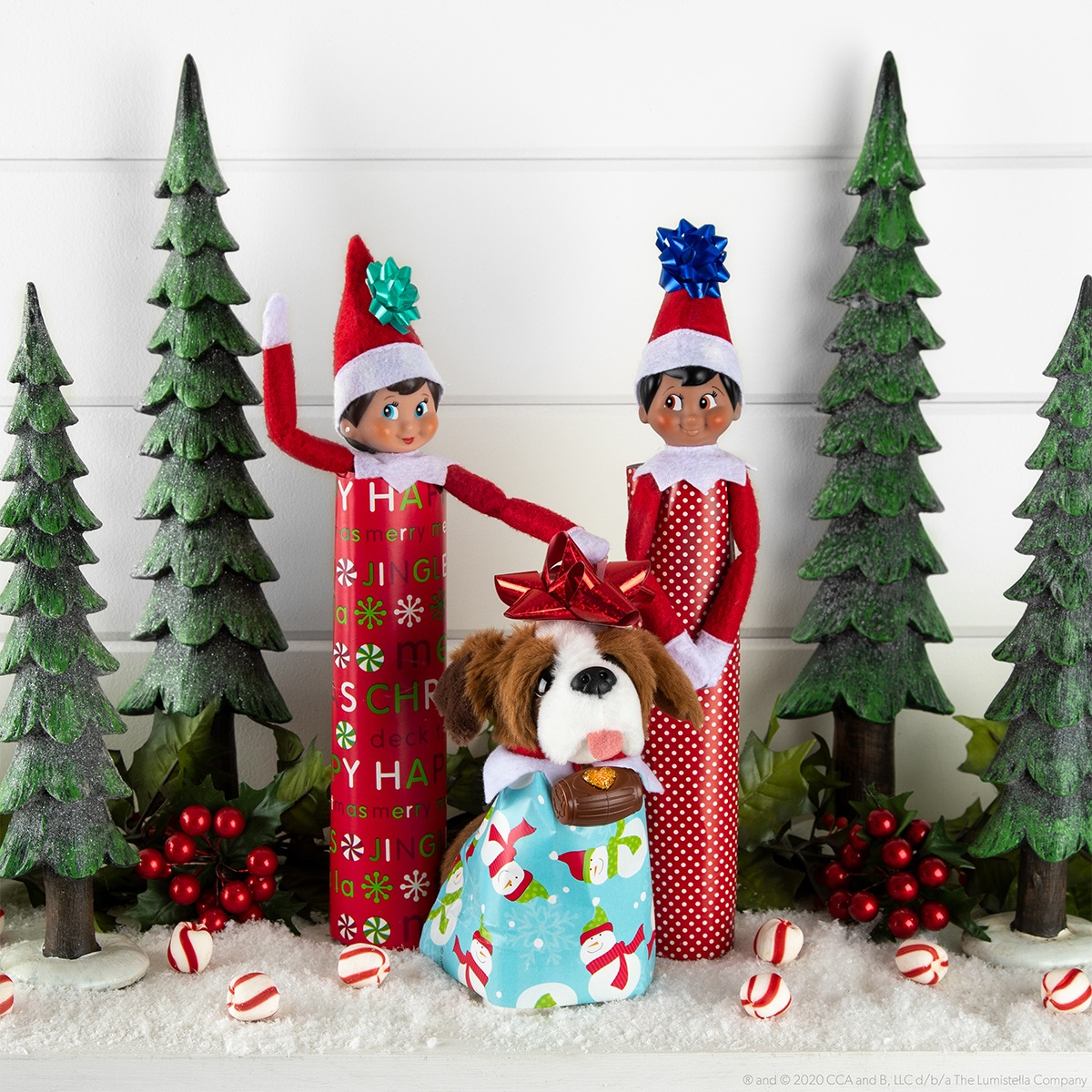 Elves wrapped up in wrapping paper