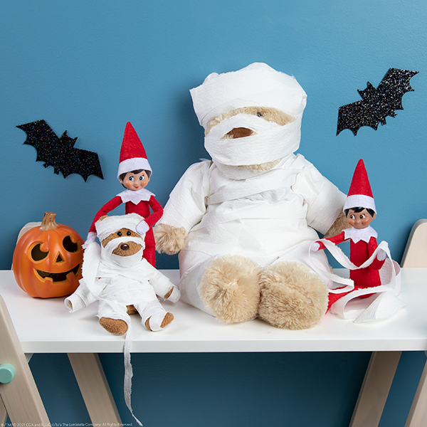 Elves with stuffed animals wrapped like mummies