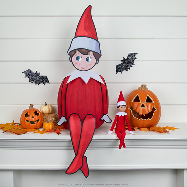 Elf created with elf printable and painted red pumpkin body